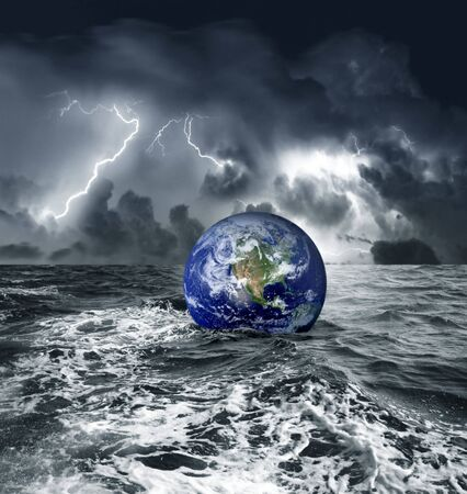 catastrophe: a earth globe sink in the sea Stock Photo
