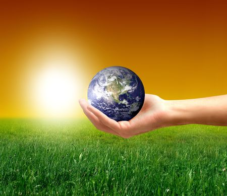 a hand with a globe and a grass field Stock Photo - 3569937