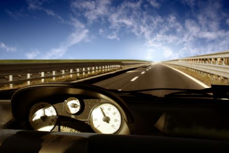 tachometer: view of highway from the car interior