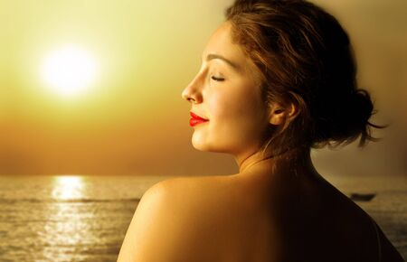 portrait of beautiful woman taking sun at sea Stock Photo - 5484328