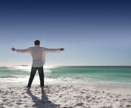 open shirt: rear view of man with open arms facing the sea Stock Photo