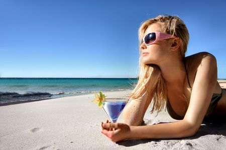 sunglasses beach: blond girl drinking cocktail on the beach Stock Photo