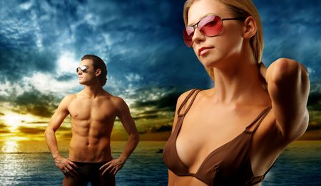 attractive couple on the beach at sunset Stock Photo - 5494964