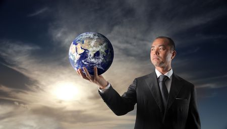 Japanese businessman holding a globe photo