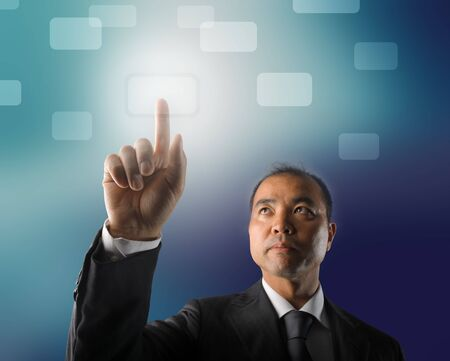 Japanese businessman using a touchpad Stock Photo - 7173145