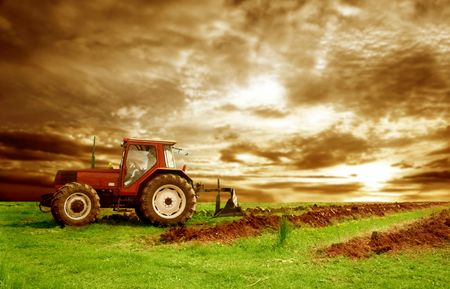 outside machines: tractor at the sunset Stock Photo