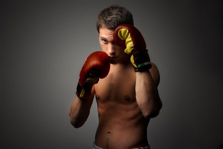 young attractive boxer on guard Stock Photo - 5582850