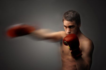 young  and handsome boxer in motion