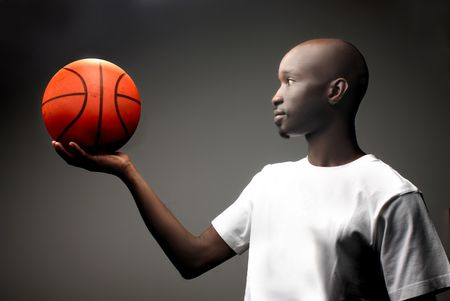 black guy with basket ball photo