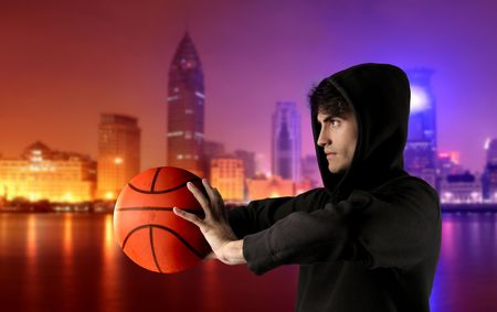 young man in panne playing basketball with city on the background Stock Photo - 5582883