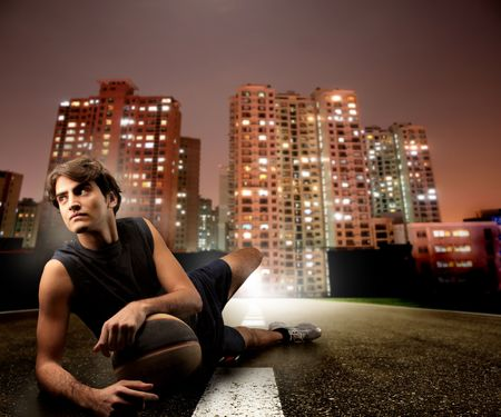 basketball player relaxing on a city road photo