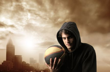 basketball player with modern city on the background photo