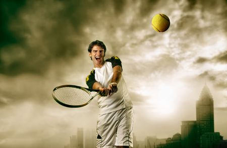 tennis ball: man playing tennis with modern city on the background Stock Photo