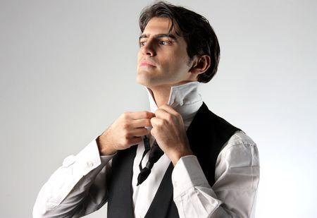 handsome groom preparing photo