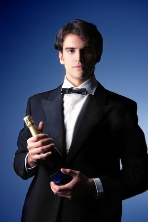 portrait of handsome legant man with a champagne bottle photo