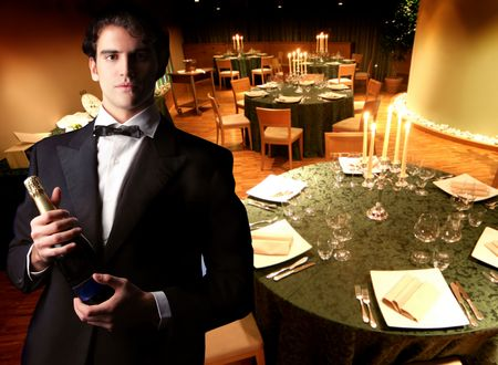 waiter with champagne bottle in a romantic dining room