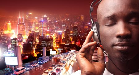 listen music: black man listening music with city view on the background Stock Photo