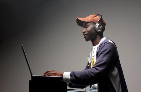 black boy loading music from internet photo