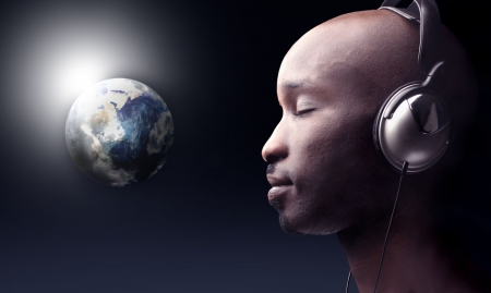american music: black man listening music and a planet earth on the background