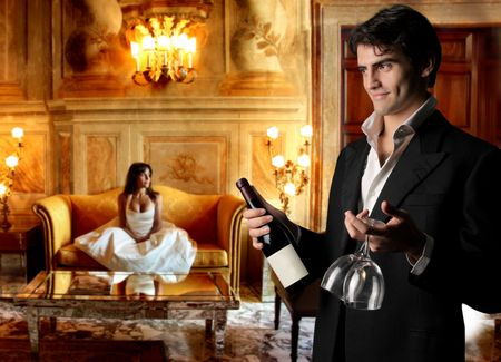 beautiful couple drinking wine after wedding photo