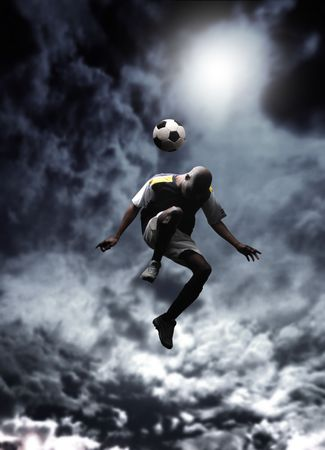 afrcican soccer player heading a ball in a stormy weather photo