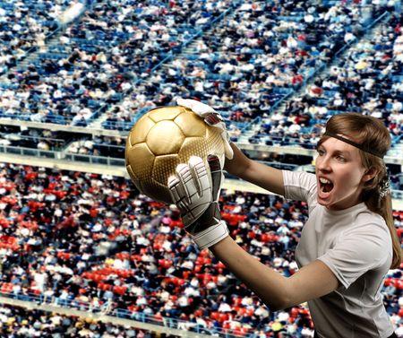 goalkeeper: female goolkeeper in a crowded stadium Stock Photo