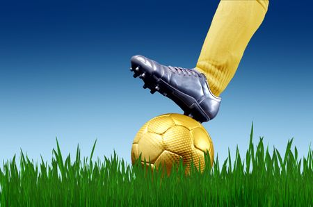 closeup of soccer player foot with ball in a grass field photo