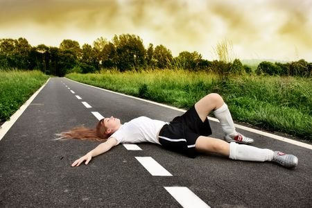 young female soccer player died on a street Stock Photo - 5611819