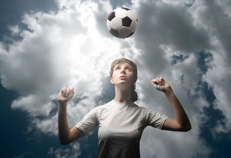 play time: female soccer or football player training