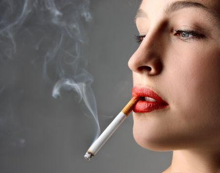 young woman smoking a cigarette  photo