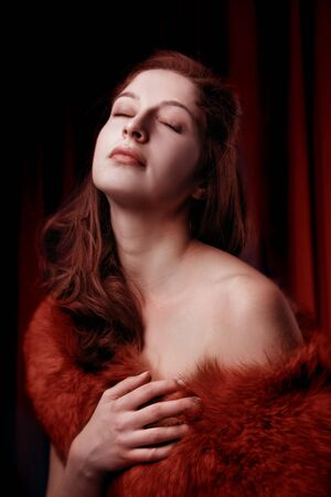 portrait of sexy young woman in red fur Stock Photo - 5619771