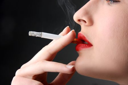 fascinating: closeup of woman smoking a cigarette  Stock Photo