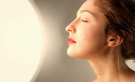 portrait of woman in a solarium photo