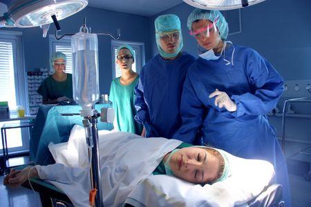 operative:  surgeons in operative room  Stock Photo