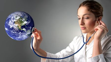 female doctor holding stethoscope on a planet earth globe Stock Photo - 5619815