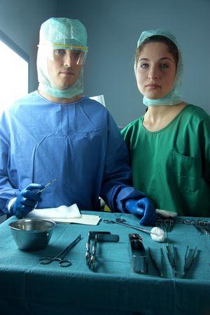 operante: chirurghi in sala operatoria Archivio Fotografico