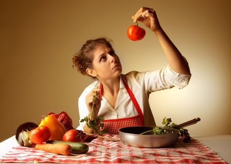 good or bad: housewife controlling vegetables for recipe