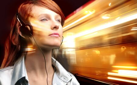 girl listening music with earphones on a light background photo