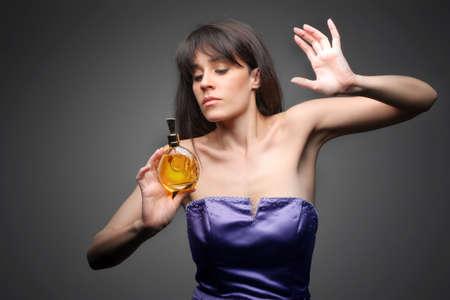 elegant lady smelling a parfume photo