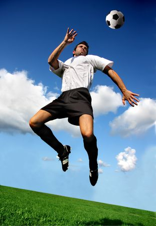 soccer players: soccer or football  player in acrobatic position Stock Photo