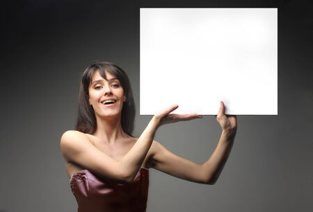 portrait of fascinating woman holding a white notice board photo