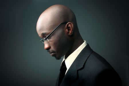 profile of african businessman with sad expression photo