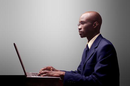 black businessman working on laptop
