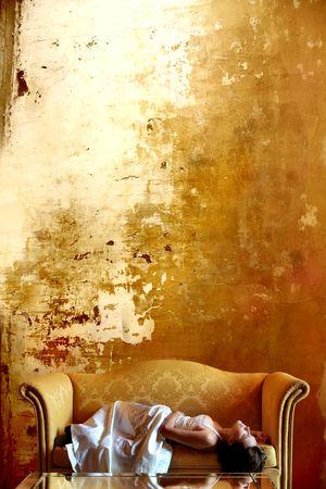 bride sleeping on a luxury sofa photo