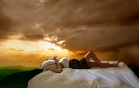 attractive woman sleeping on a bed with a beautiful valley on the background Stock Photo - 5703663