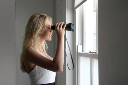 panoramic windows: young woman with a binoculars