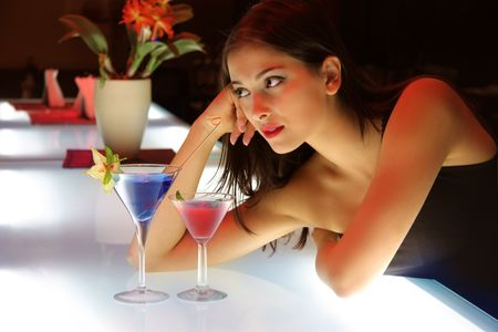 portrait of a young woman in a cocktail bar  photo