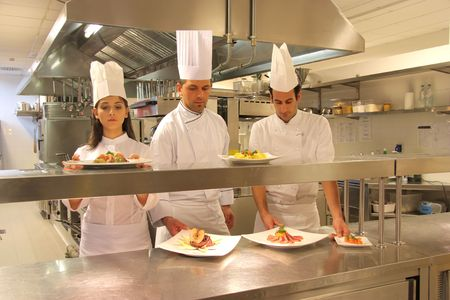 cooks in a kitchen of a restaurant photo