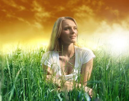 beautiful woman in a grass field photo