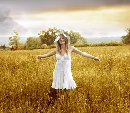 beautiful young girl in a golden field photo